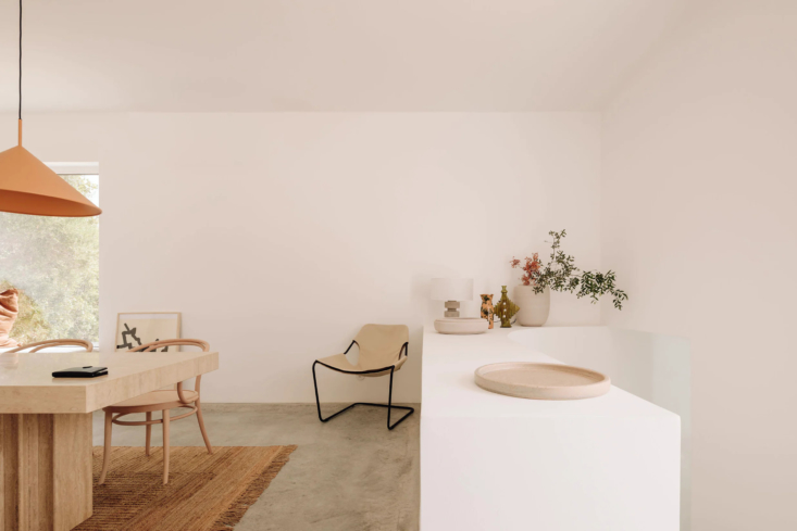 One Two Three Minimalist Guesthouses on the Coast of Portugal Pools Included Sculptural lines and furniture in the guesthouse dining room, formerly the farm stables.
