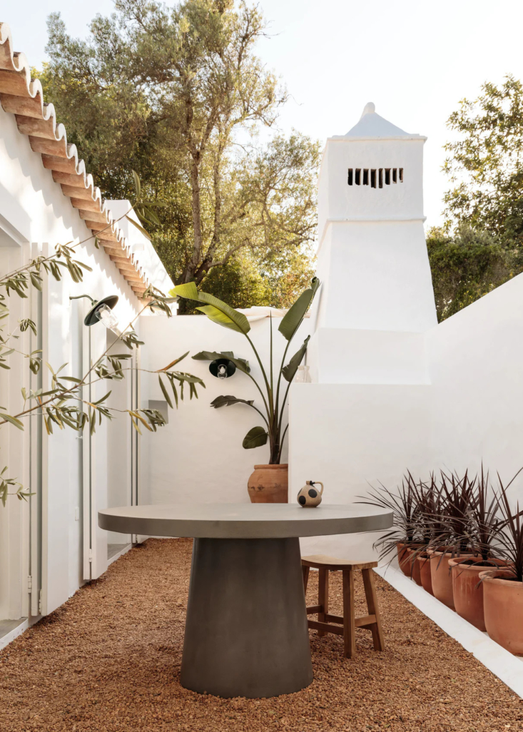 One Two Three Minimalist Guesthouses on the Coast of Portugal Pools Included The pocket sized patio is set in what was once the barn. Note the original bread oven built into the wall.