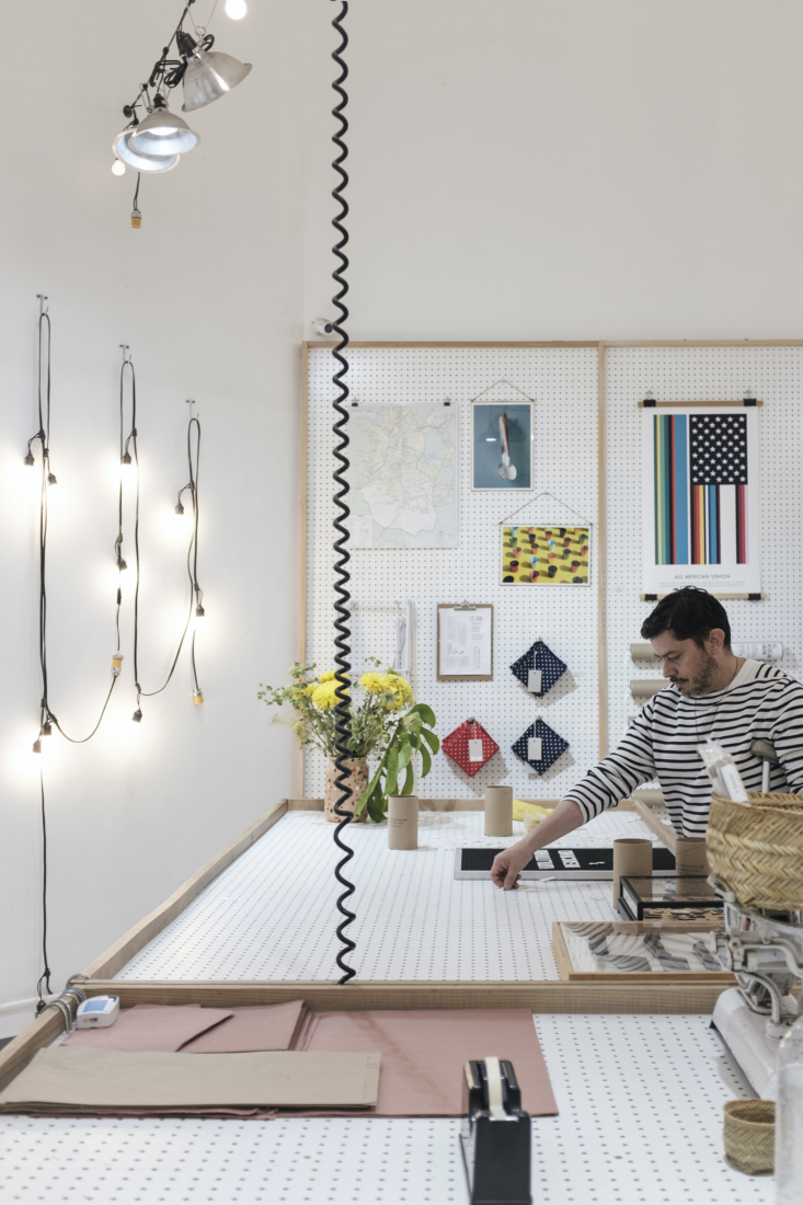 Enrique puts together a letter sign. The Fairy Lights on the wall are $4.77 per meter.