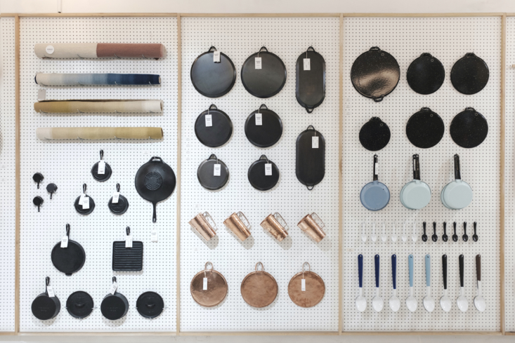 The Cast-Iron and Copper departments. Shown in the upper left: naturally dyed Wool Rugs, $6., woven by Maria Romero in Oaxaca. Enamelware Coffee Spoons are $5 and two-toned Serving Spoons are $.08.