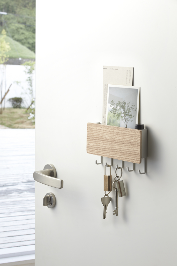 Above: Never waste time searching for your keys: The Rin Magnetic Key Rack with Tray ($) has hooks for keeping keys handy, plus a slot for storing mail, papers, or sunglasses. The magnetic rack can be wall-mounted using a screw or simply affixed to metal doors or surfaces for easy install.
