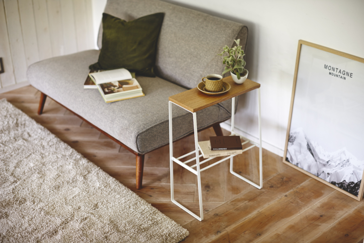 Above: Yamazaki offers small space-friendly furniture, too, like the steel and wood Tosca Narrow Living Room End Table ($65), which adds storage to the living space or bedside without taking up room.