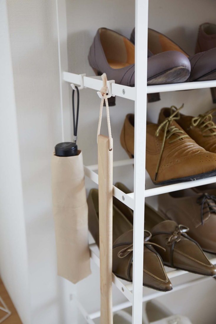 Above: An example of Yamazaki's thoughtful, detail-oriented design: The shoe rack also includes hooks on the side for storing umbrellas and other hanging items.