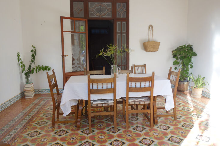 original floor tiles add the only color to the bright and simple dining room. ( 21