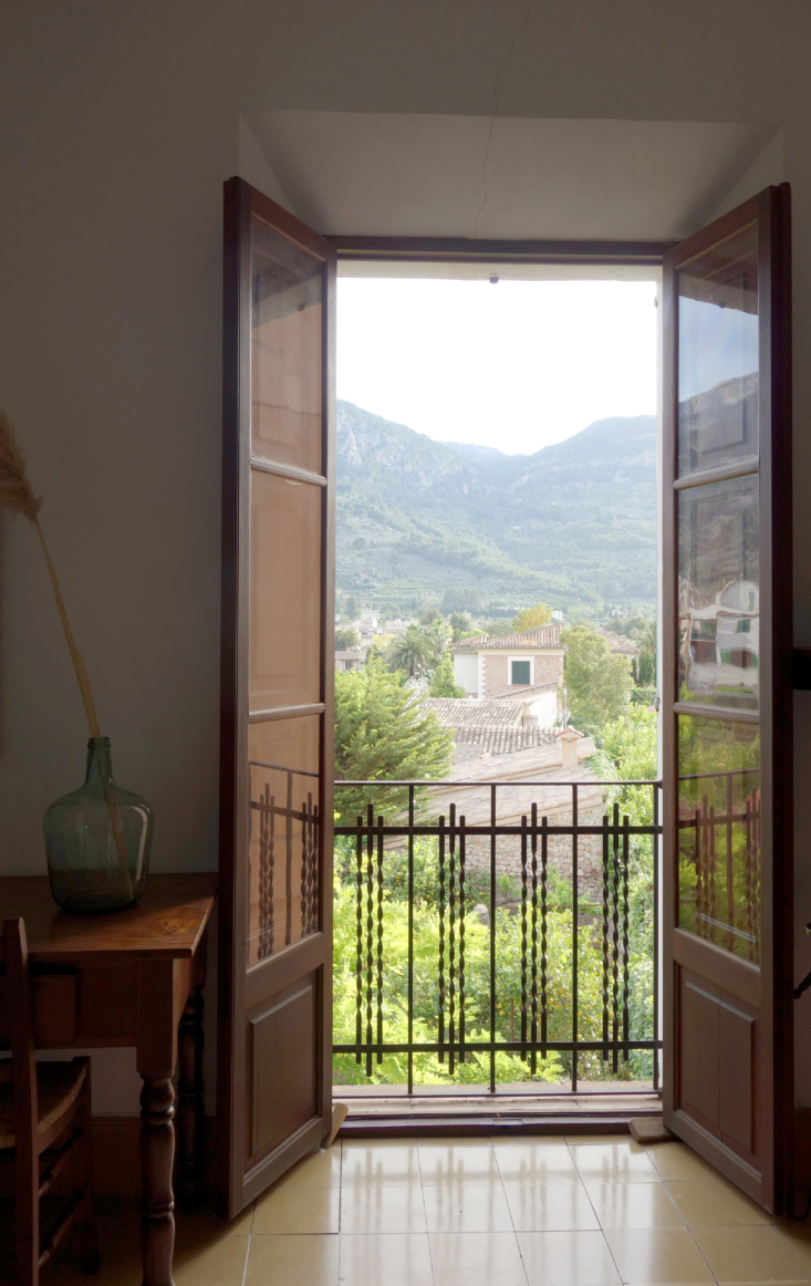 french doors and a juliette balcony look out at the mountains. 28