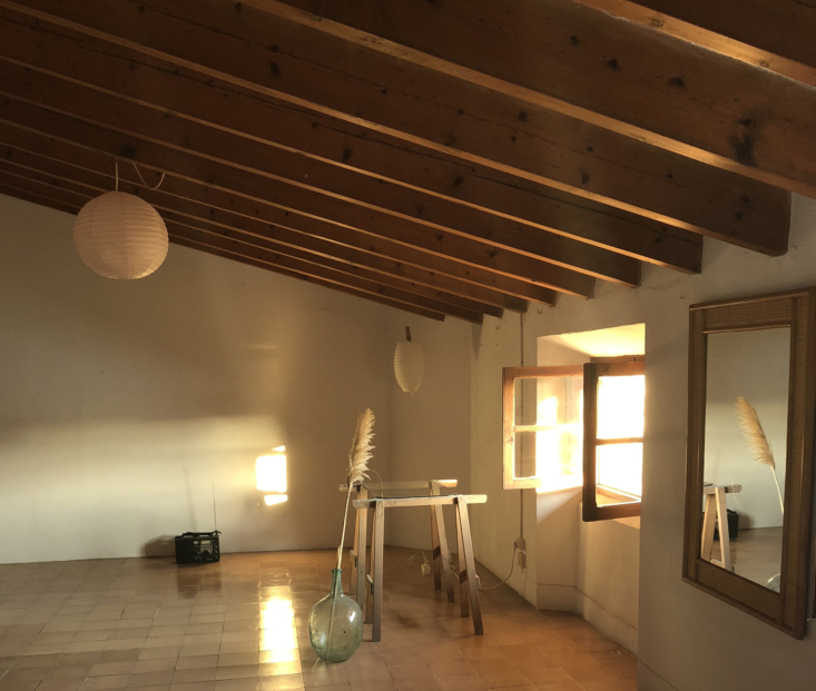 the open top floor bedroom in late evening sun. 29