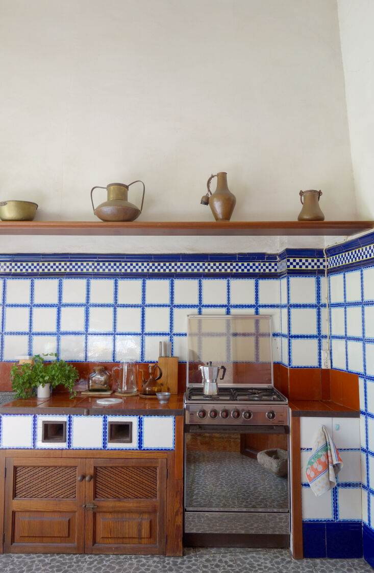 carved wood meets mix and match tile in the maximalist cookspace. 19