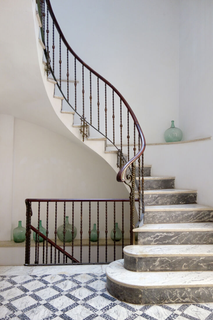 a grand spiral staircase in varieties of marble connects each of the floors—a 24