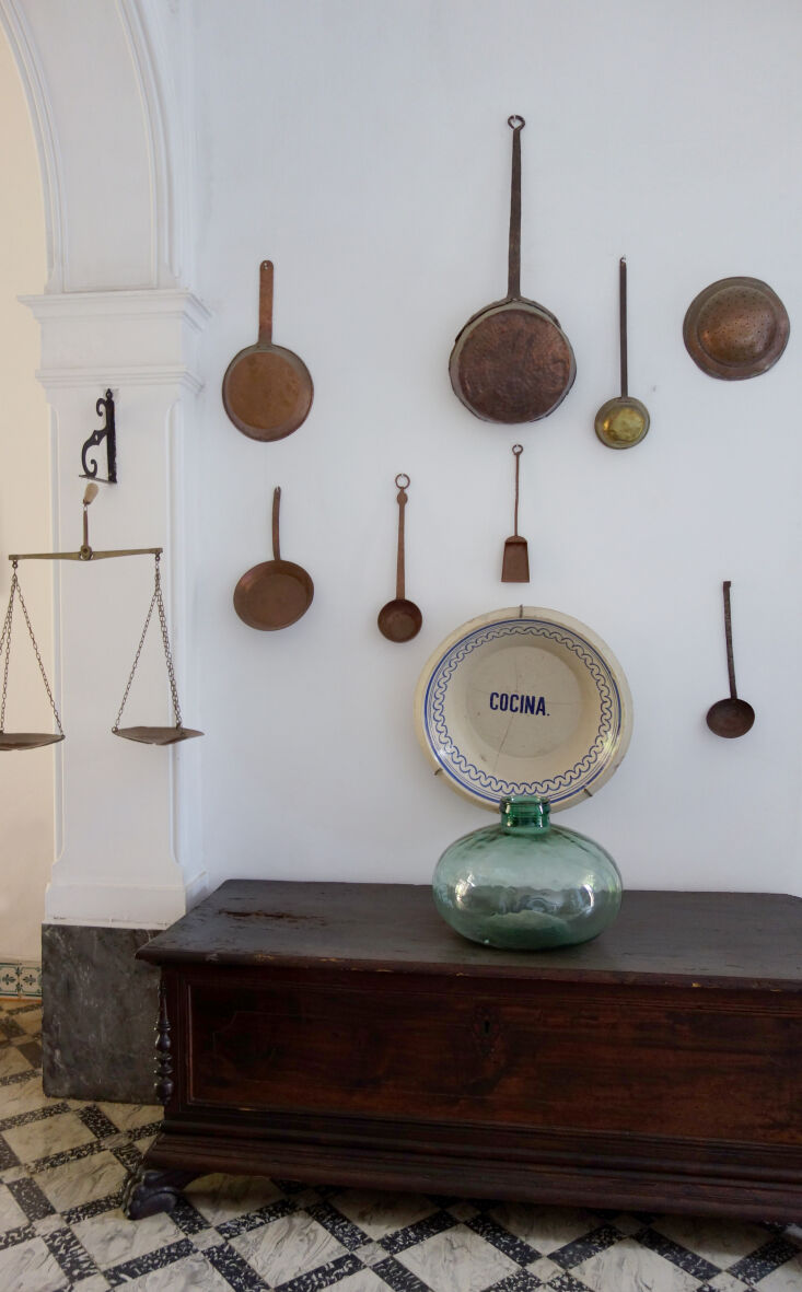 copper pots make for a charmingly ad hoc wall display. 20