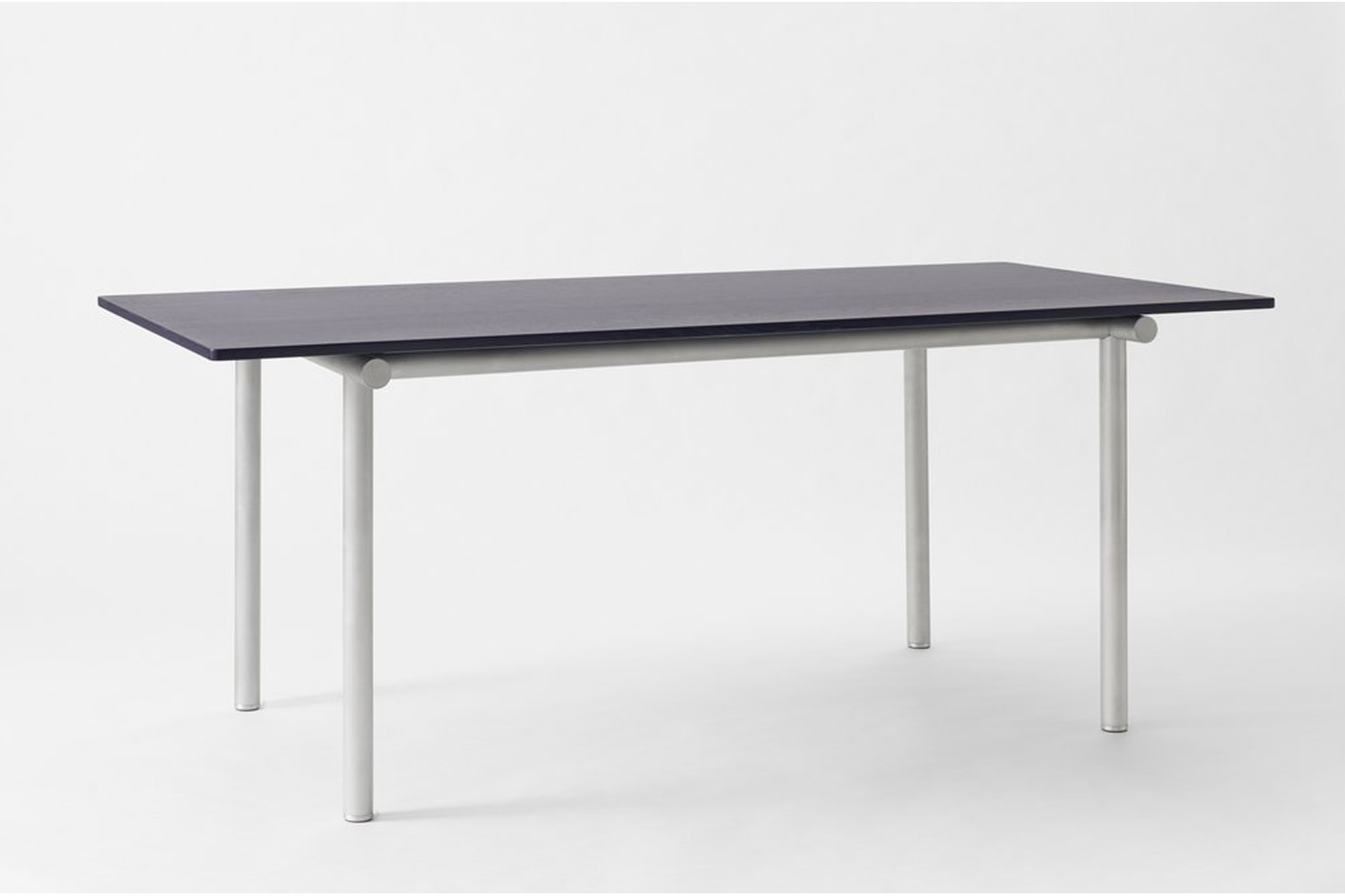the faye toogood tubby tube navy ash and aluminum dining table is designed with 10