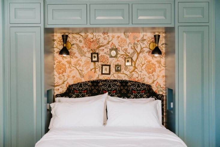 A jaunty wallpapered niche with a mix-and-match headboard.
