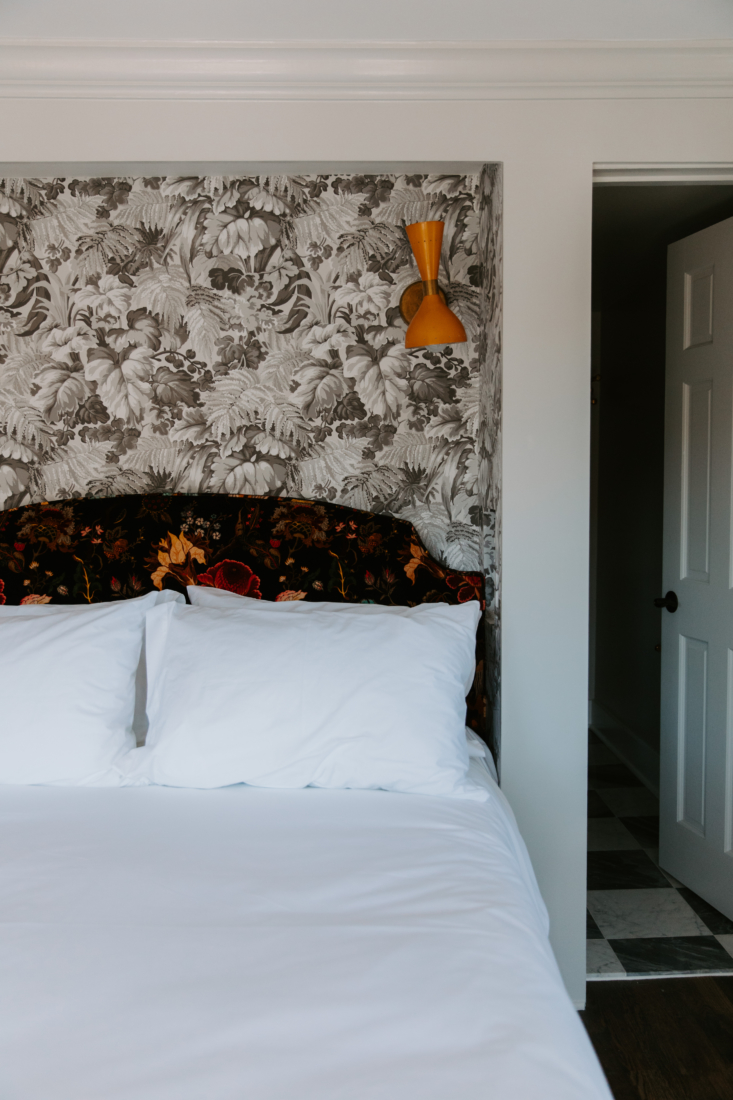 The  guest rooms are all done in delightfully mismatched patterns, with wallpapers and upholstered headboards from the likes of Morris & Co., Pierre Frey, Mulberry Home, Cole & Son, and House of Hackney.