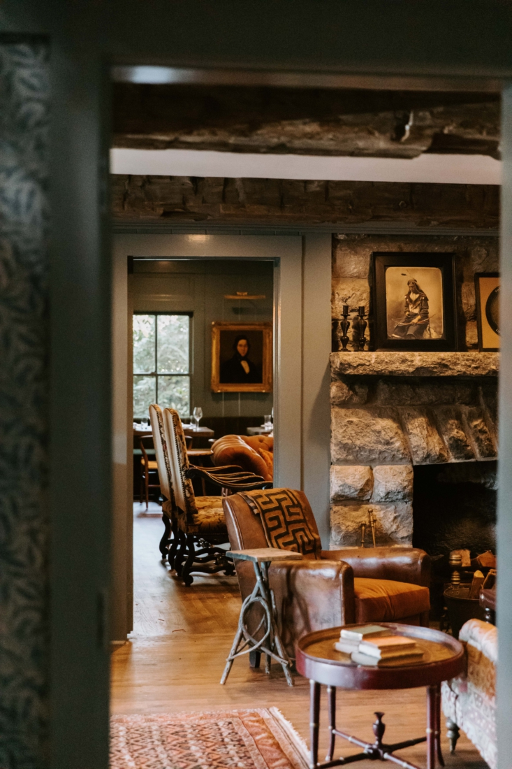 One of the communal living areas, with a stone fireplace and easy furnishings.