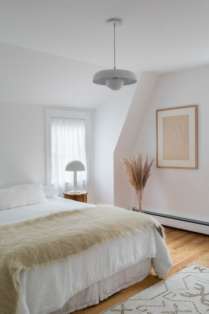 A Petite 1901 House in Concord MA Redone by a Former Magazine Creative The couple&#8\2\17;s bedroom is fitted with Zara Home linen bedding, a wool throw from Ukraine based Etsy shop Lijnik, and an Anthropology ceiling light. &#8\2\20;It was black and gold, and I had my painter paint it white,&#8\2\2\1; Nikki says.