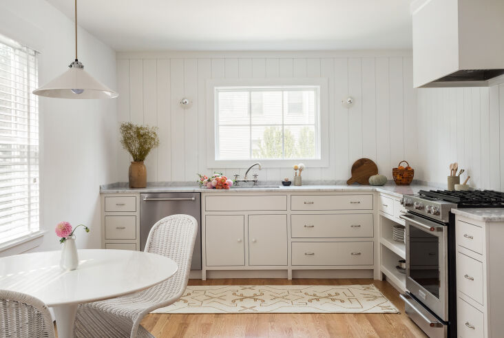 A Petite 1901 House in Concord MA Redone by a Former Magazine Creative &#8\2\20;The kitchen had a 3&#8\24\2; x 3&#8\24\2; mudroom imposing into it, making little room for prep space, and a tiny off center window,&#8\2\2\1; recalls Nikki. She demoed the mudroom and side entry to allow the new kitchen to expand. A bigger, centered window takes the place of the old small one, with sconces from Schoolhouse on either side.