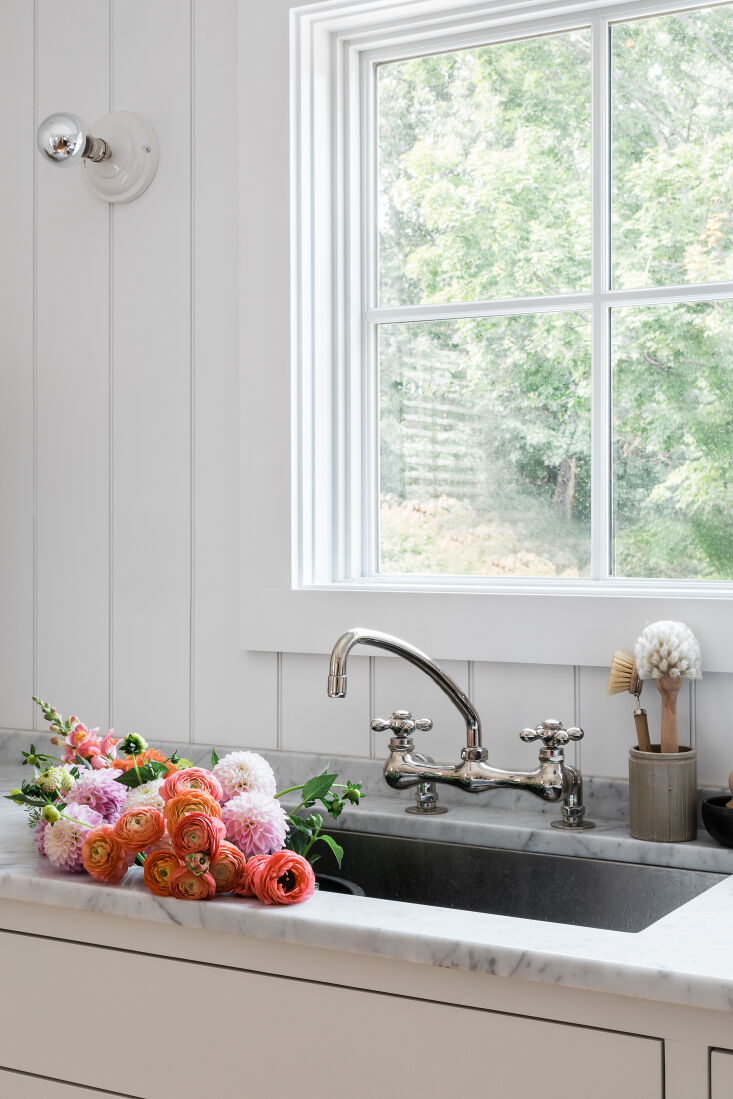 A Petite 1901 House in Concord MA Redone by a Former Magazine Creative The kitchen is fitted with marble counters, beadboard cladding, and a &#8\2\20;zero radius&#8\2\2\1; stainless sink (meaning it has no curves, just 90 degree angles). &#8\2\20;I designed and drew the cabinets and sent the drawings directly to the fabricator out in the country,&#8\2\2\1; says Nikki. &#8\2\20;I decided on only lower cabinets to make the small kitchen feel bigger. The only cabinet doors are under the sink; the rest are drawers, and I love the functionality. When I pull out a drawer I can see everything and everything is at my fingertips.&#8\2\2\1;