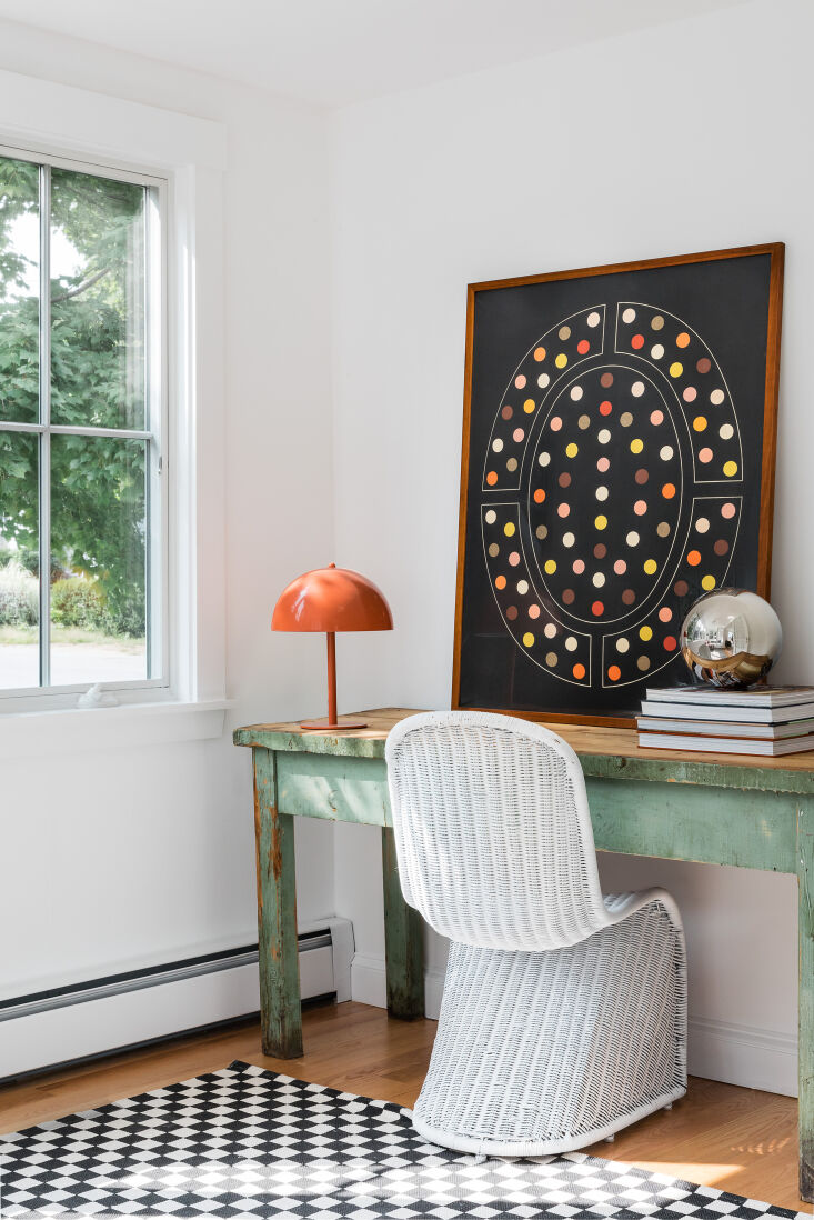 A Petite 1901 House in Concord MA Redone by a Former Magazine Creative A cheerful porch office setup. &#8\2\20;I love lighting. A lot,&#8\2\2\1; Nikki says. &#8\2\20;It&#8\2\17;s so sculptural. It&#8\2\17;s like jewelry. I love to buy lighting from makers on Etsy. I also have a lot of Schoolhouse fixtures in my house.&#8\2\2\1; The vintage desk is from The Vintage Retriever Found Goods & Homewares in Holden, MA, and the dot art piece is from Visual Contrast.