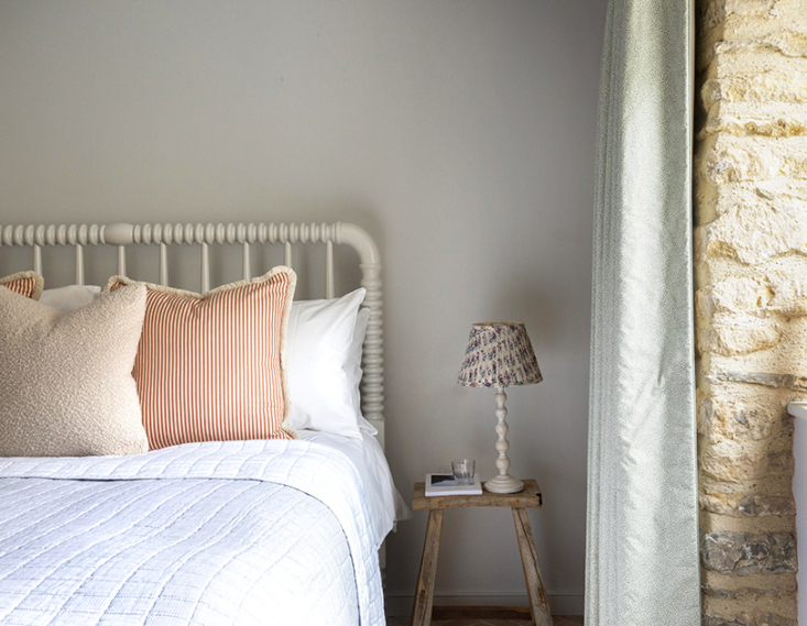 an embroidered bedspread and an of the moment patterned bedside light in cottag 18
