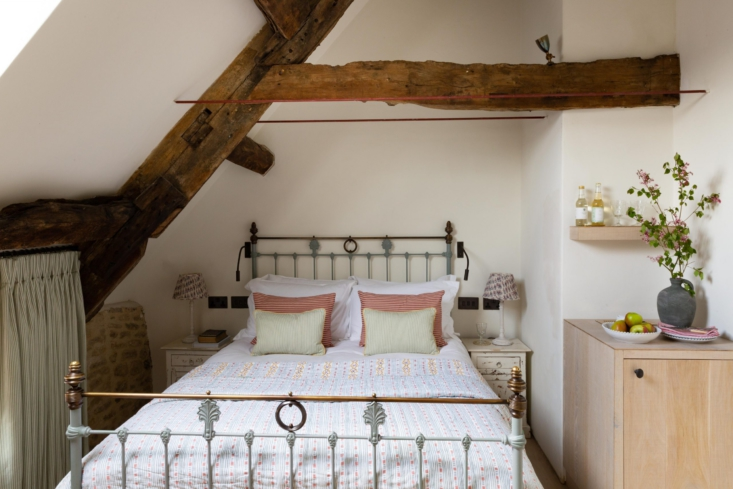 a sweet coverlet and painted bed frame in the forge. 21
