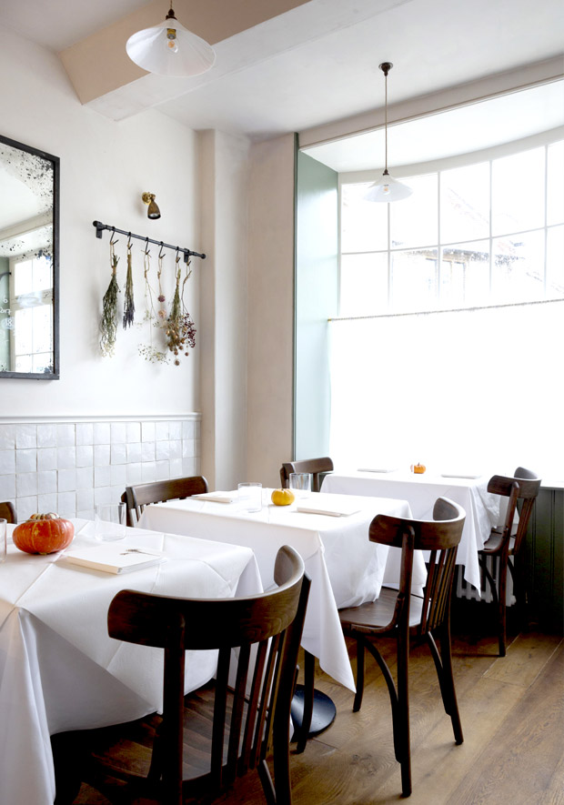 the restaurant, with zellige tiled walls and dried flowers. for much more on os 11
