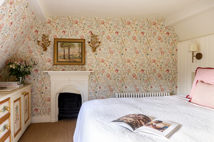 townhouse 4 features a \16th century fireplace, white painted wood paneling, an 14