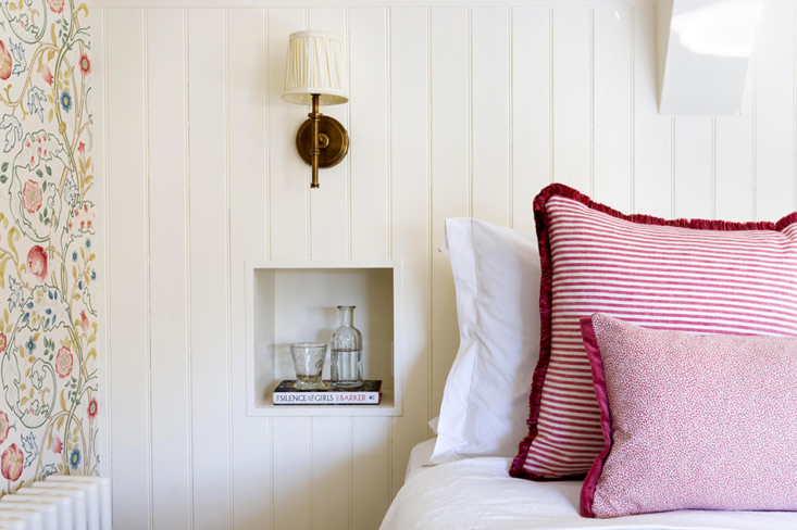a bedside niche and striped pink pillows. 15