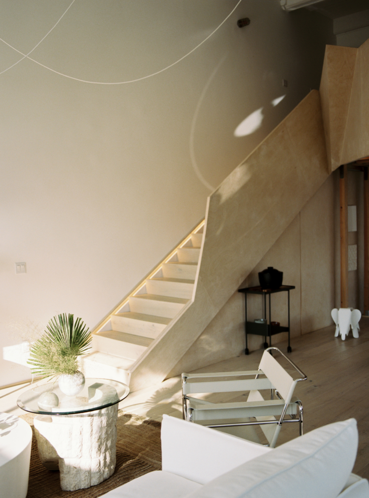 for access to the mezzanine, the architects designed a geometric wood stair rai 15
