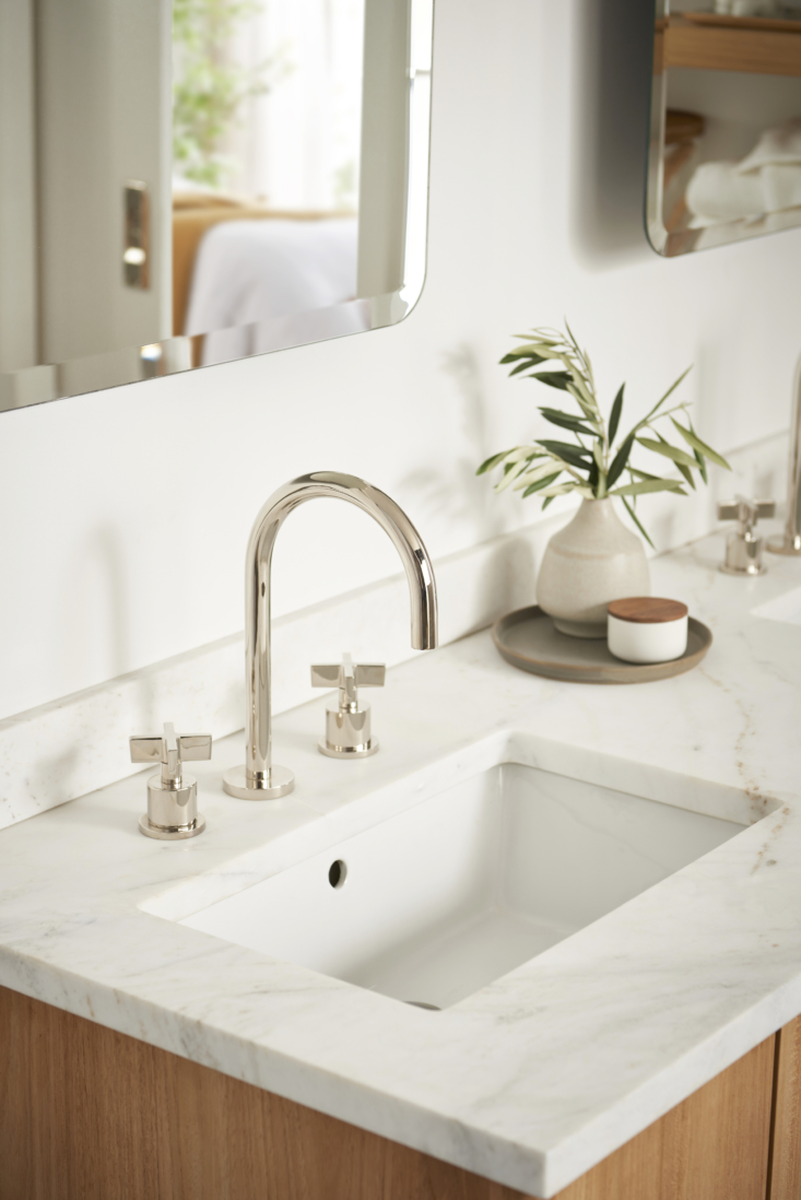 the sink is fitted with the west slope cross handle bathroom faucet (\$999) fro 16