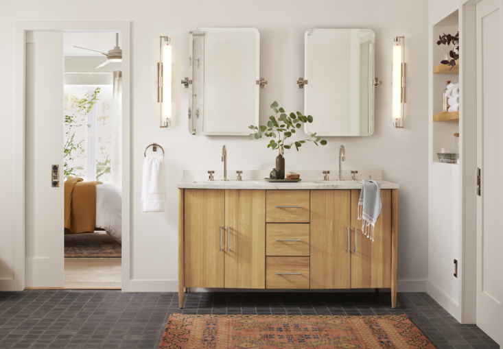 the guest bath, with twin west slope frameless rounded rectangle pivot mirrors  12