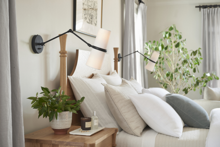 two conifer articulating sconces in oil rubbed bronze (\$449 each), mounted on  11
