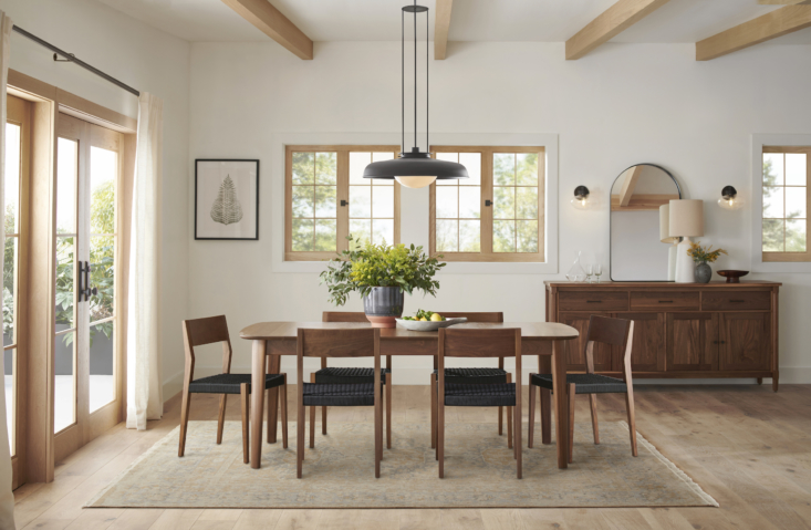 Above: The makings of a dinner-party-ready dining room: the Colfax Extendable Rectangular Walnut Table ($3,499), inspired by 40s Swedish design; clean-lined and comfortable Bayley Side Chairs with Woven Rope Seats (from $349); and the statement-making S Ormandy Rod Pendant (shown in oil-rubbed bronze, $loading=