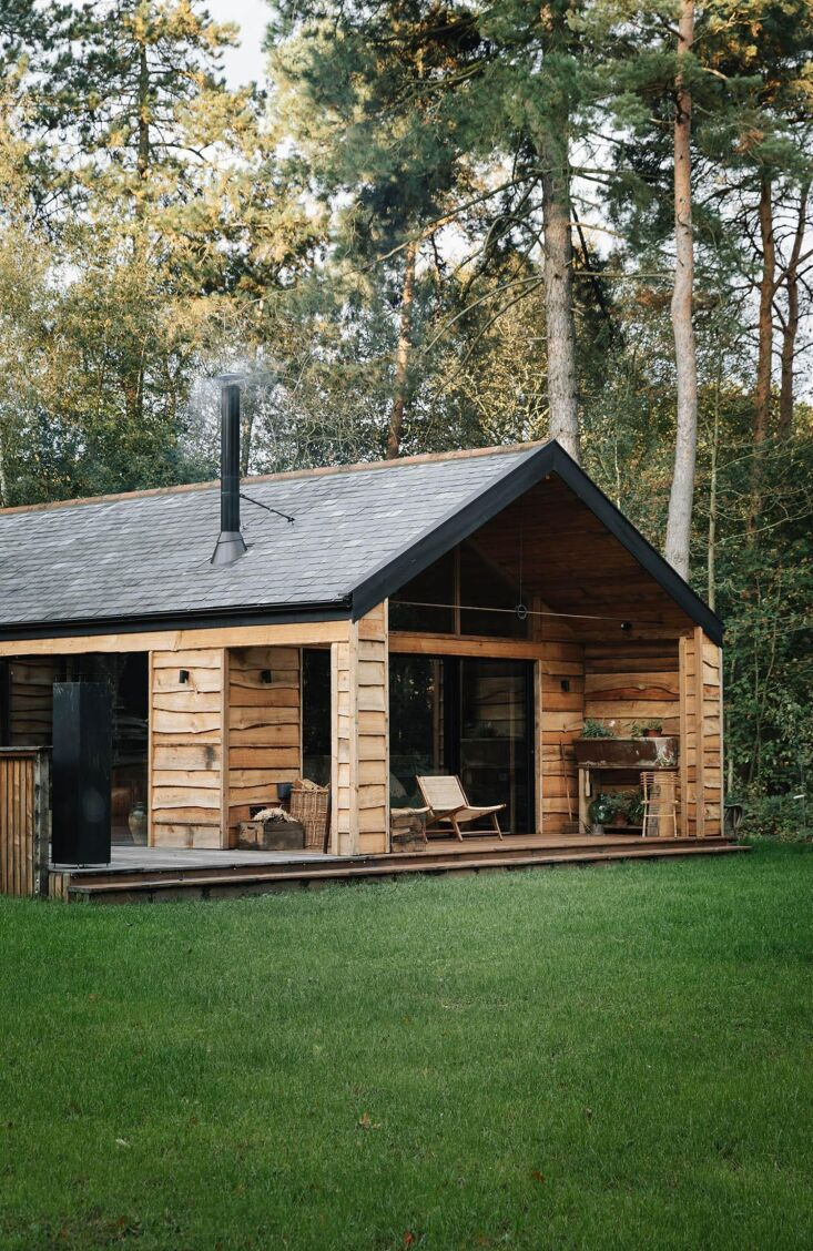Retreat for Two A Lakeside Rental Cabin at Settle in Norfolk England The cabin overlooks a lake with swans.