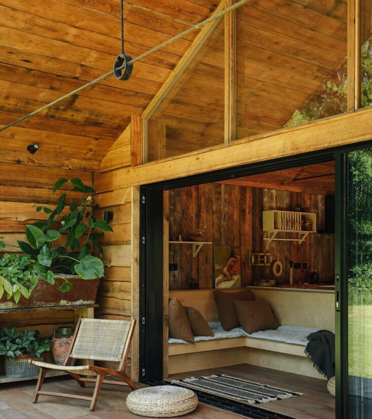 Retreat for Two A Lakeside Rental Cabin at Settle in Norfolk England Sliding glass doors and a newly addedn built in bench link indoors to out.