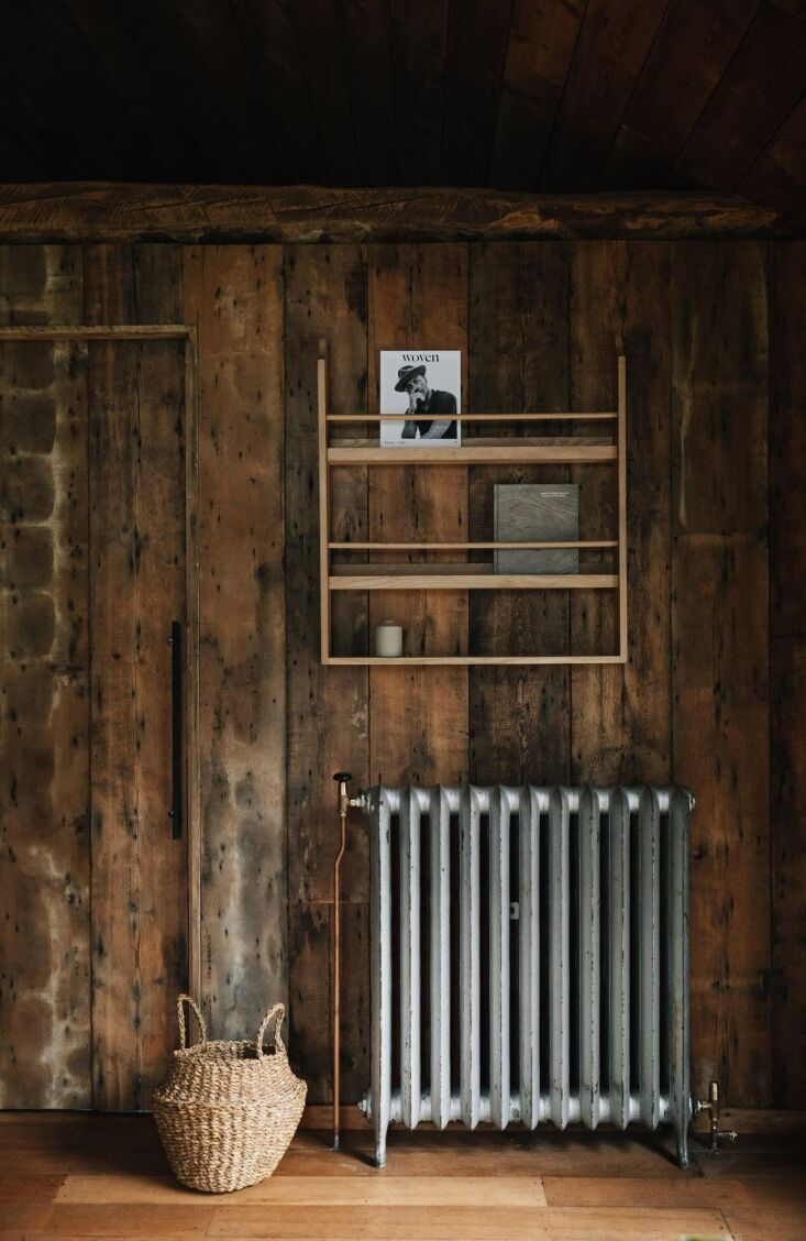 Retreat for Two A Lakeside Rental Cabin at Settle in Norfolk England The cabin is heated with vintage cast iron radiators as well as a new wood burning stove.