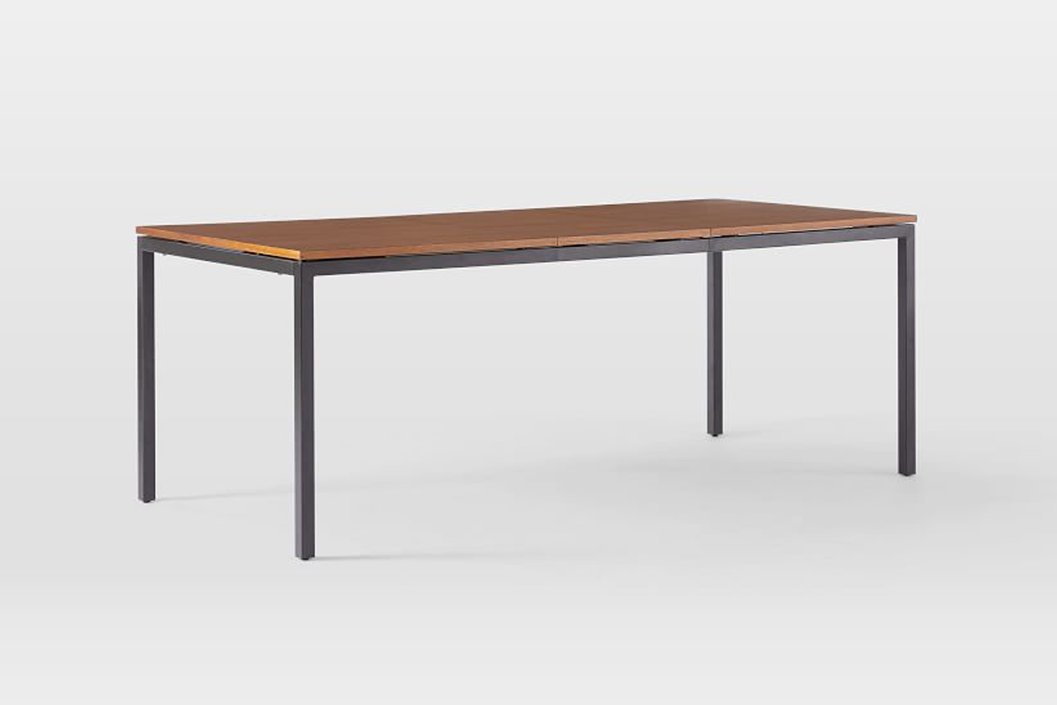 the west elm frame expandable dining table sits on an antique brass or antique  14