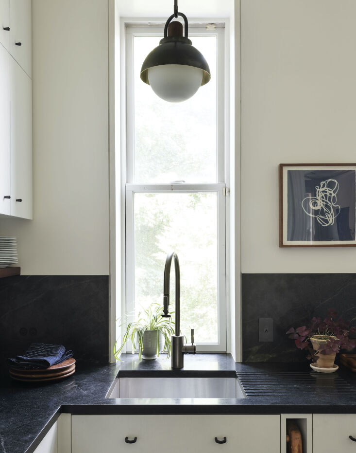 roberts replaced her crumbling concrete counter with china black soapstone from 11