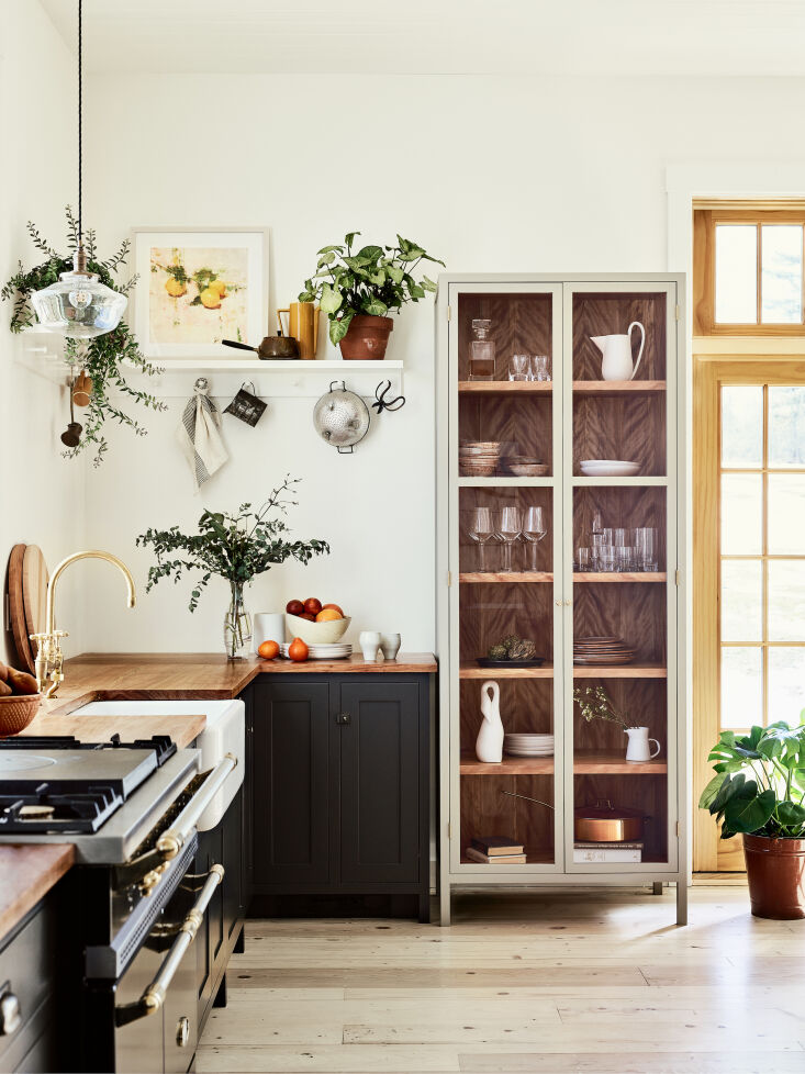 on one end of the kitchen is a glass fronted display cabinet, in keeping with t 15