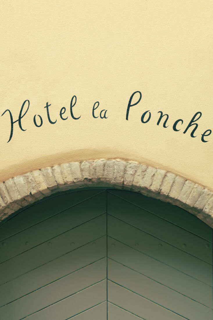 a hand painted sign greets visitors. 26