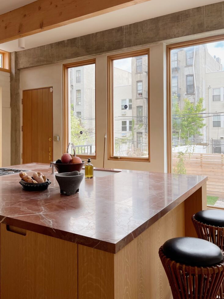 the custom millwork is oak topped with rosso collemandina marble. the \1960s co 16