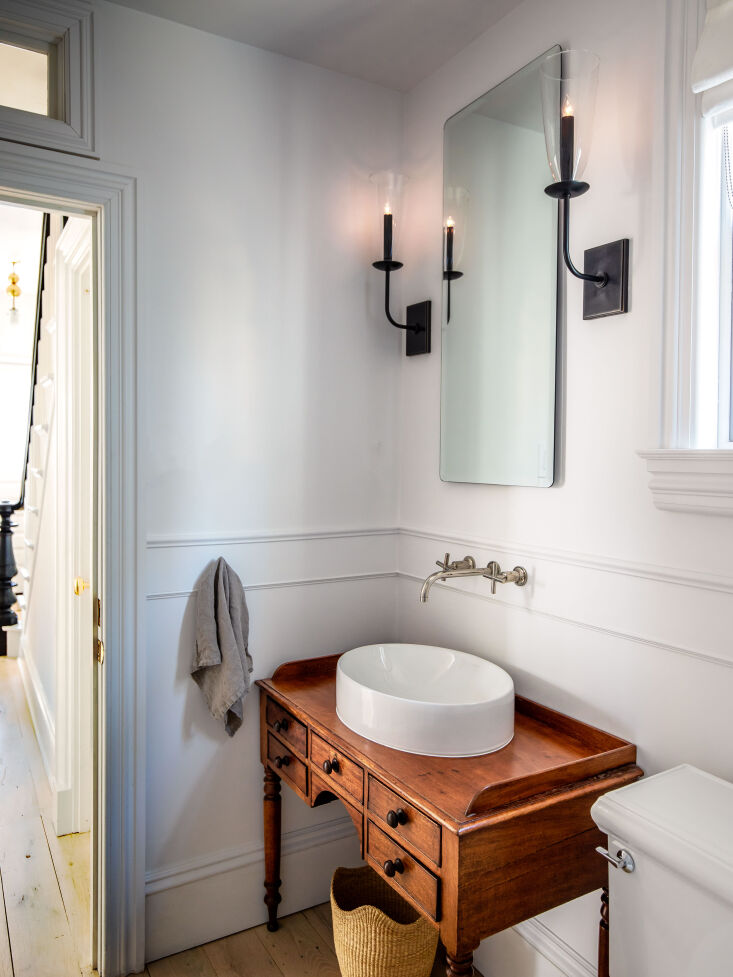 the cottage has one bathroom, which krissy gutted and fitted with an antique ed 16