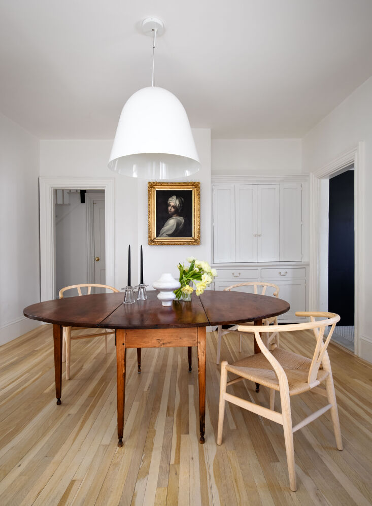 the pared back dining room, with newly added reclaimed white oak floors (&# 13