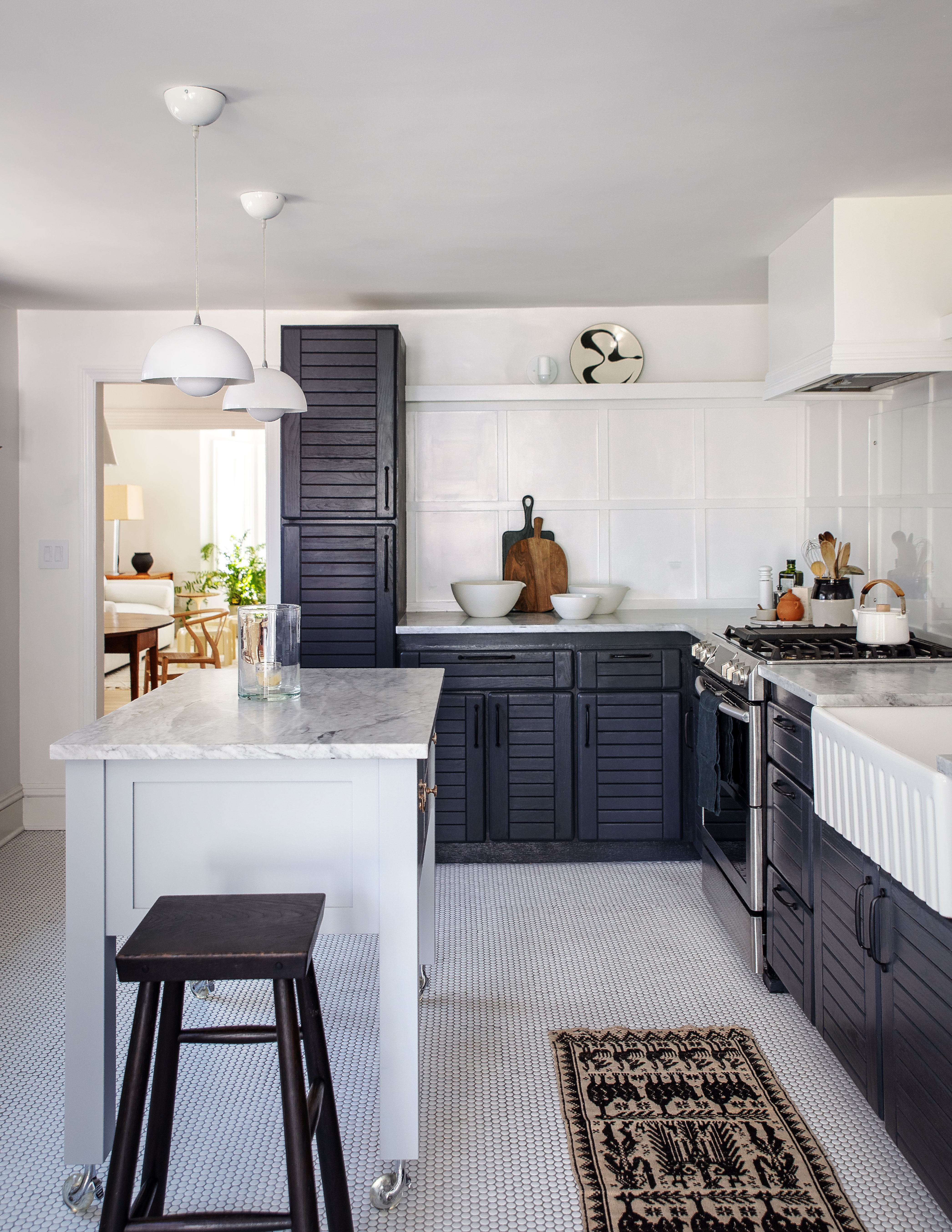 the white and dark gray kitchen is compact (just \280 square feet) but designed 9