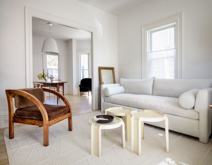 the living area in shades of white. the interiors (except for the bathroom) are 15