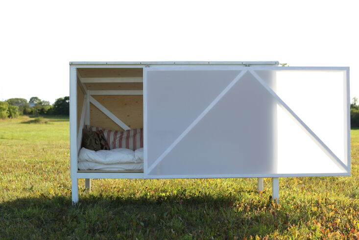 the doh studio micro cabin, with a door of ripstop sail fabric, is designed to  14