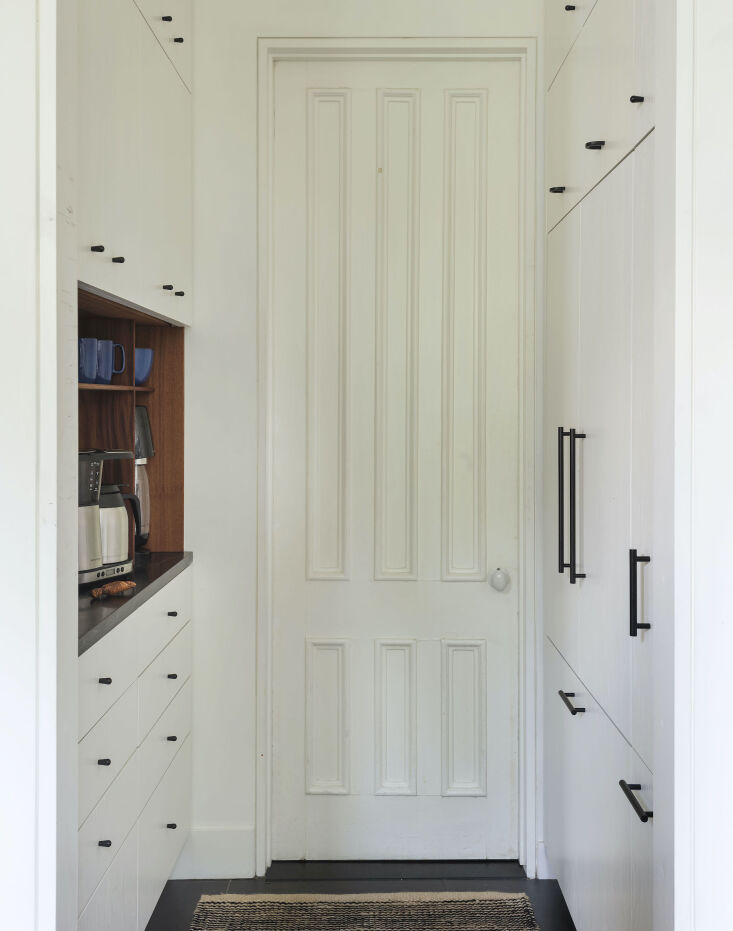 the walk through pantry, located in the passage from the front hall to the kitc 14