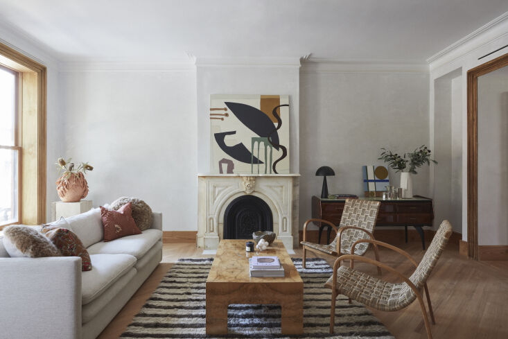 the architects restored the living room to its original dimensions and preserve 10