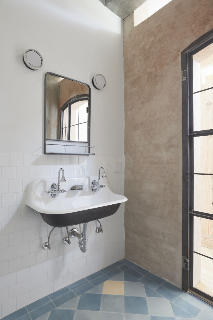 the bath has a double utility sink—the wall mounted brockway from kohler with 21