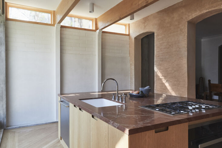 &#8\2\20;the kitchen design is centered on a large island, placing emphasis 15