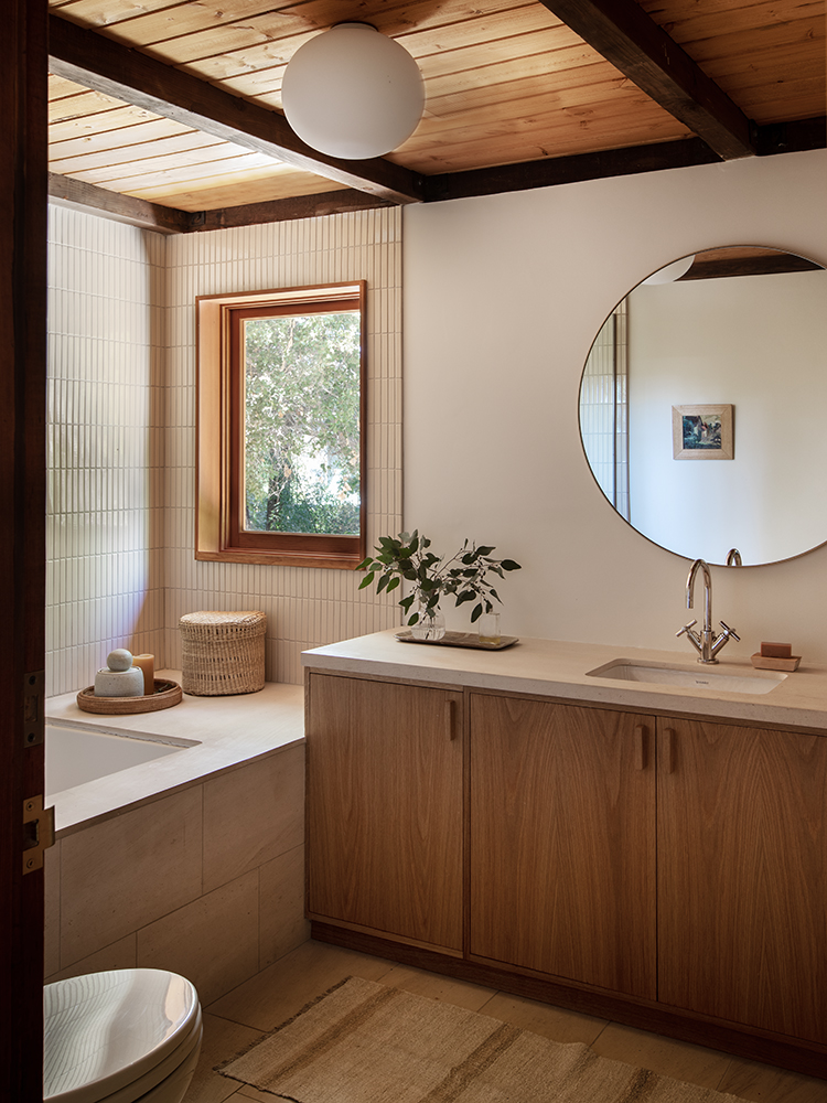 the custom millwork seen on the bath console here, like the work throughout the 10