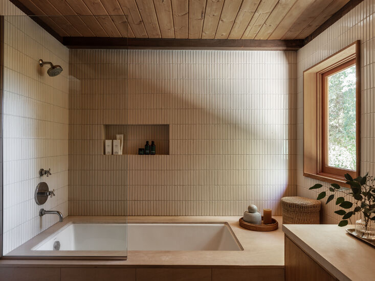 the bath features fireclay tile, a niche for storing products, and a window wit 23
